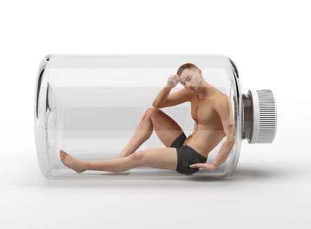 Man sitting inside a glass bottle  photo