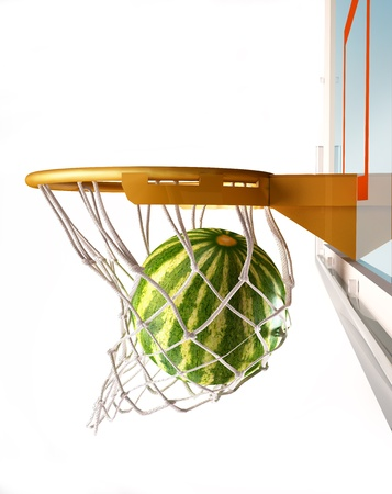 centering: Watermelon centering the basket (of basketball), with the melon inside the net, close up view, on white background. Stock Photo