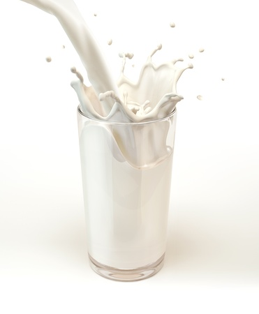 Fresh milk pouring into a glass with splash. On white background. Imagens