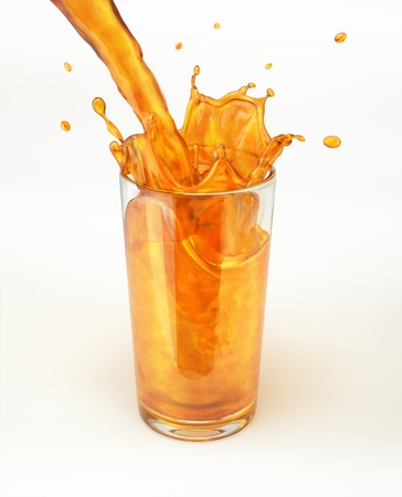 Orange juice pouring into a glass, forming a splash. On white background, with clipping path. Reklamní fotografie