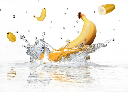 Banana splashing into clear water on white background. photo