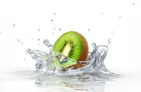 purified: kiwi splashing into clear water on white background.