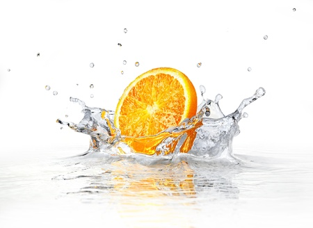 Orange slice falling and splashing into clear water. On white background.