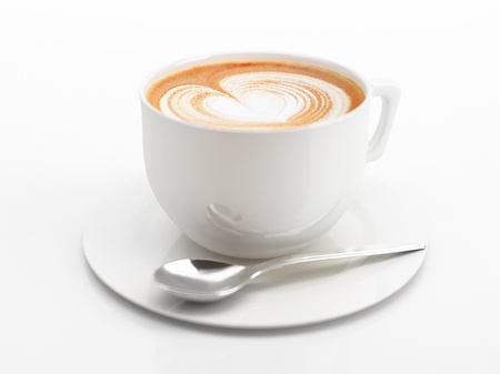 Cappuccino mug close up, with a heart decorated on top of foam. Some depth of field effect. On white background with clipping path. Imagens