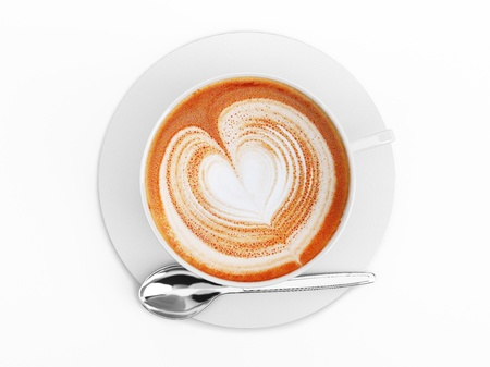 Cappuccino mug close up, with a heart decorated on top of foam. Top view. On white background with clipping path.