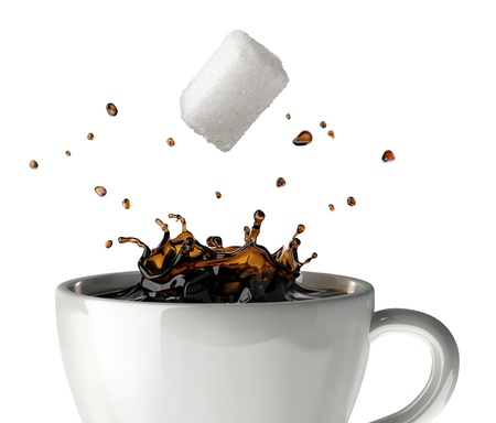 sugar cube: Sugar cube falling and splashing into a cup of black coffee  Close up view  On white background Stock Photo