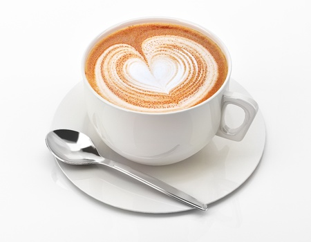 mocha: Cappuccino mug close up, with a heart decorated on top of foam  On white background with clipping path