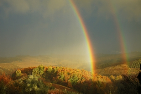 Double rainbow on a beautiful hills scenery in Tuscany,  Italy