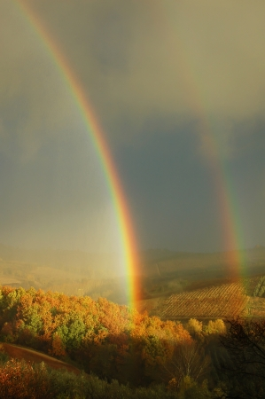 rainbow clouds: Double rainbow on a beautiful hills scenery in Tuscany,  Italy