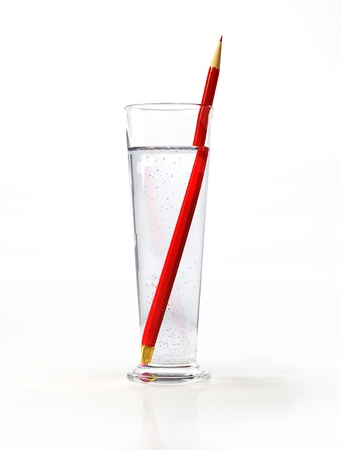 Tall glass of water, with a red pensil inside  On white surface and background