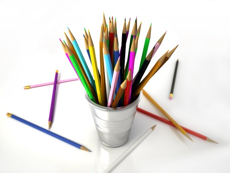 Several Multicolored pencils into a metallic jar, with some on the white floor  on WHite background photo