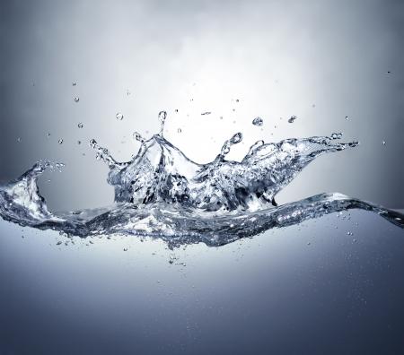 Crown splash in troubled clear water  Side view  Standard-Bild