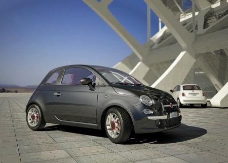 Fiat 500 city car, outside of a modern industrial building environment, in daylight