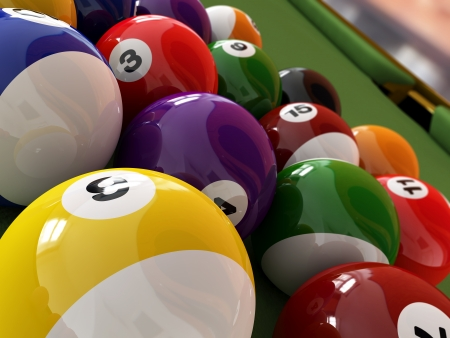 snooker room: Group of billiard balls with numbers, on green pool table, with a hole in the background  Close up view