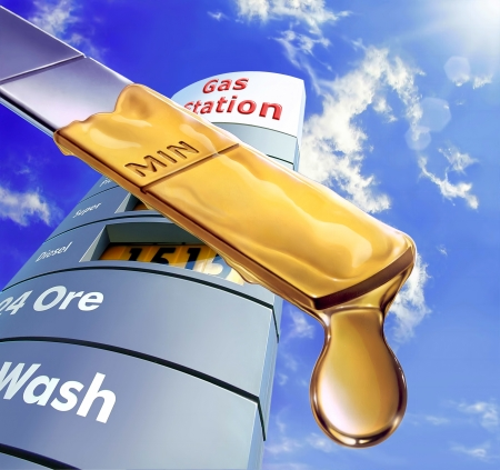 high price of oil: Close up of an engine dipstick, with an oil drop at the edge of it  Blue sky and fluffy clouds and a gas station sign in the background