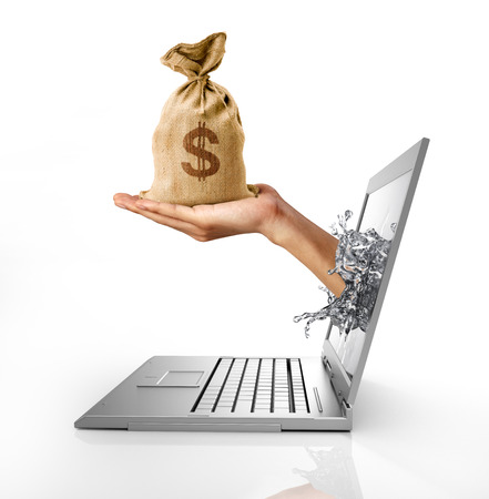 coming out: Human hand with a bag of US Dollars, coming out from computer screen