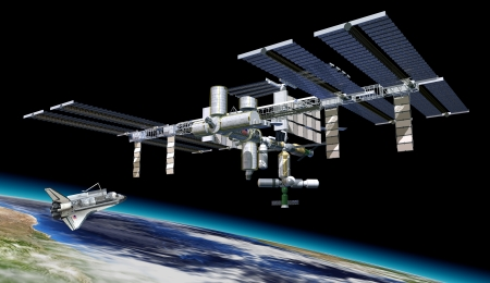 Space station in orbit around Earth, with Shuttle. A portion of the Earth at the bottom. Imagens
