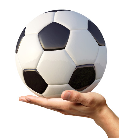 Man s hand with a typical soccer ball on it  photo