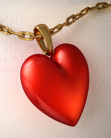 Red shiny heart pendant, with gold chain, placed on a white paper  photo