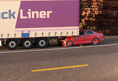 Two cars accident. Crashed cars. A red coupésedan against the back of a big truck. Big damage. On the road with environment background.