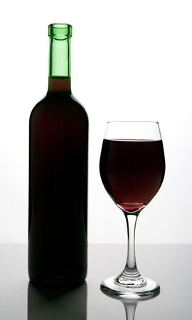 bottle and red wine Standard-Bild