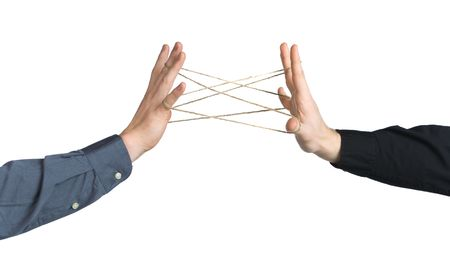 Hands playing with rope, symbolising connectivity, friendship, strong bonds photo