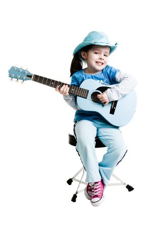 Young girl playing on a guitar while sitting on a white background Stock Photo