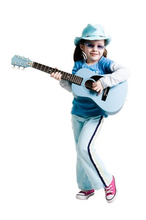 Young girl playing on a guitar while standing on a white background