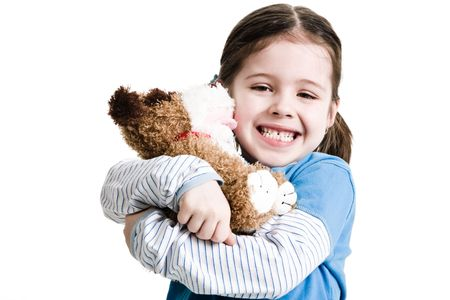 Young female child hugging stuffed animal on a white background Stock Photo