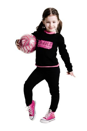 Young girl standing while holding a soccer ball on a white background