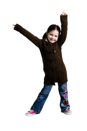 Young girl posing with arms in the air on a white background Stock Photo