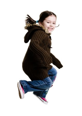 Young girl jumping in the air on a white background