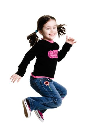 children acting: Young girl jumping in the air on a white background