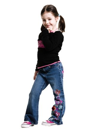 Young girl standing on a white background