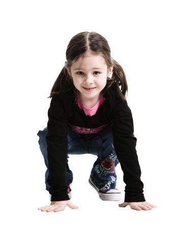 Young girl crouching on a white background Banco de Imagens