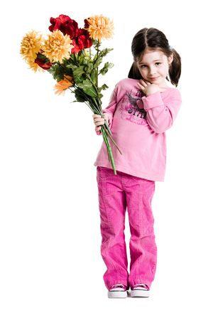Young girl holding a bouquet of flowers on a white background