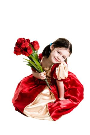 Young girl wearing a red dress sitting down and holding a bouquet of flowers on a white background