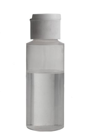 Clear bottle filled with clear liquid on a white background Stok Fotoğraf