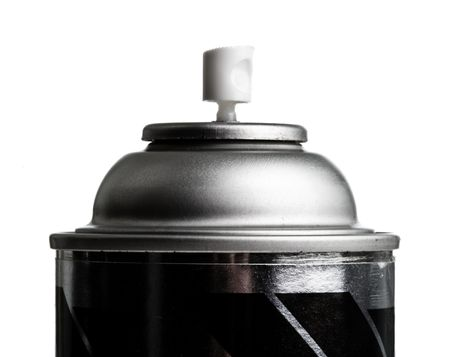 Close up of a spray can on a white background