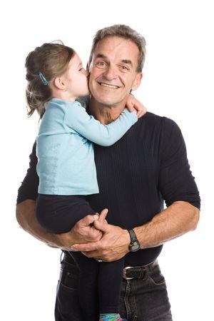 白い背景の上に彼の孫娘を保持している祖父 写真素材