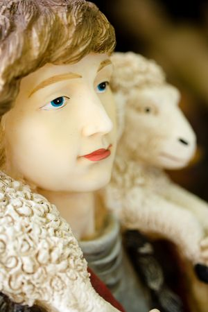 Nativity figure of person and a lamb or sheep Stock Photo