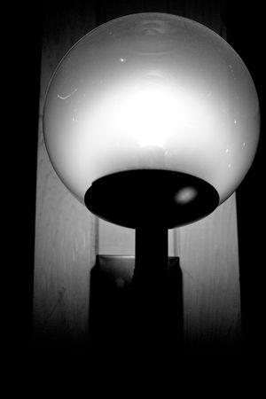 irradiate: A light fixture that is on in the dark