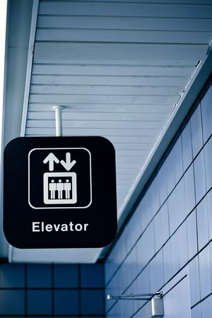 Elevator sign in a public place Stock Photo