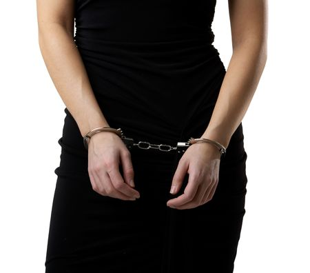 Female body in a black dressed wearing handcuffs Stock Photo