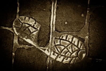 dirty feet: Human Footprint on a Grunge Concrete floor