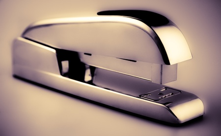 office stapler: A small steel Business Stapler with nobody Stock Photo