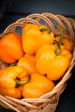 Group of Orange peppers in a basket