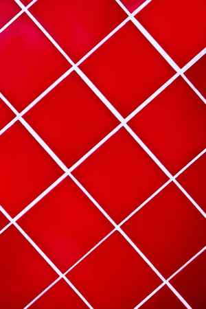 Close up of a red  tiled background