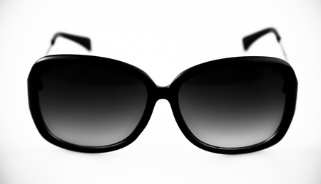 tinted: Sunglasses with plastic frame on white background