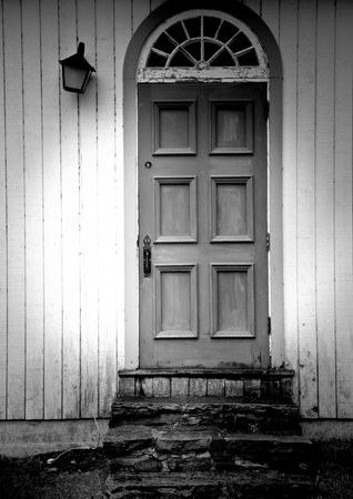 Old vintage wooden door black and white with nobody